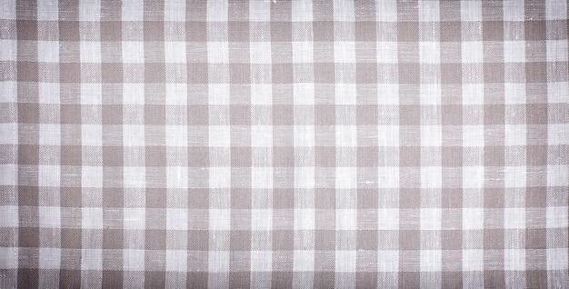 Beżowy obrus w kratę, brązowa tkanina dekoracyjna tekstylna, tekstura