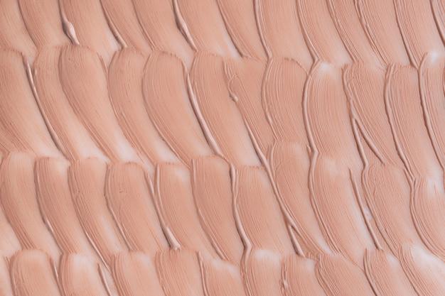 Beżowy rozmaz tekstury podkładu. koncepcja kosmetyków.