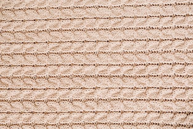 Beżowy wzór tekstury wełny z dzianiny