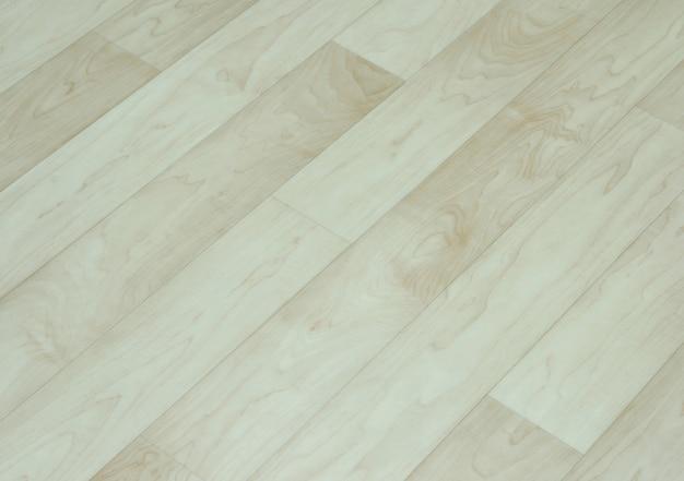 Beżowym tle drewnianej podłodze
