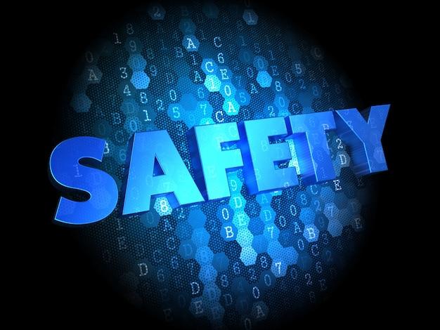 Bezpieczeństwo - tekst w kolorze niebieskim na ciemnym tle cyfrowym.