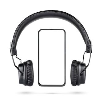 Bezprzewodowe czarne słuchawki nauszne i telefon komórkowy bez ramki z pustym ekranem izolowanym