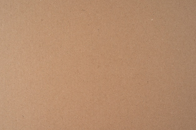 Bezszwowa powierzchnia recyklingu brązowego papieru kartonowego tekstury tła do wykorzystania projektu w wysokiej rozdzielczości i widocznej tekstury, miejsce na kopię, leżał płasko