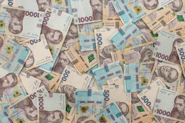 Bezszwowa tekstura prawdziwej nowej ukrainy banknotów 500 i 1000