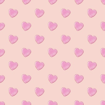 Bezszwowy wzór pętli z ciasteczkami w kształcie serca ozdobionymi białą glazurą na różowym tle