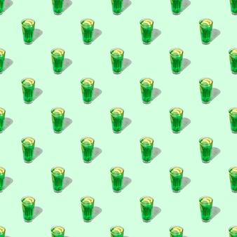 Bezszwowy wzór pętli z przezroczystą szklanką zielonego napoju