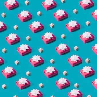 Bezszwowy wzór różowi prezentów pudełka