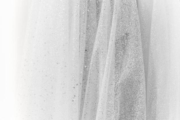 Biała bawełniana tkanina z błyszczącą teksturą tła z brokatem.