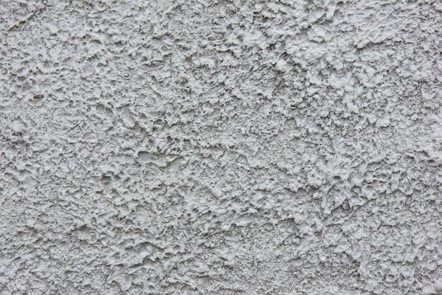 Biała betonowa ściana do wnętrz lub polerowanego betonu odkrytego na zewnątrz.