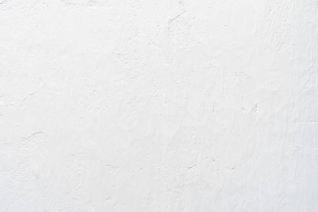 Biała betonowa tekstura na ścianie z światłem słonecznym dla abstrakcjonistycznego tła.