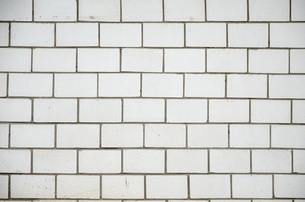 Biała ceglana ściana, idealna jako tło, kwadratowa fotografia