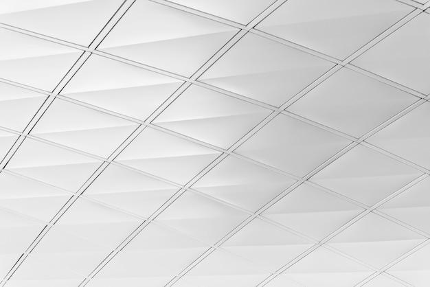 Biała dachowa tekstura. abstrakcyjne tło. wzór nowoczesnej architektury urządzony w budynku.