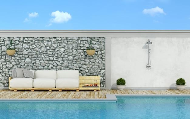 Biała kanapa na paletach przy basenie