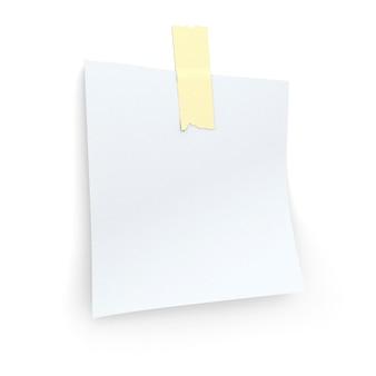 Biała karteczka samoprzylepna przyklejona do ściany za pomocą taśmy klejącej