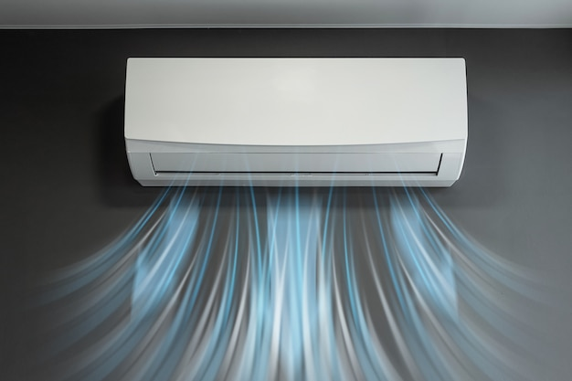 Biała klimatyzacja i strumień świeżego zimnego powietrza na ścianie szarej ściany. pojęcie ciepła, chłodnego powietrza, chłodzenia, świeżości.