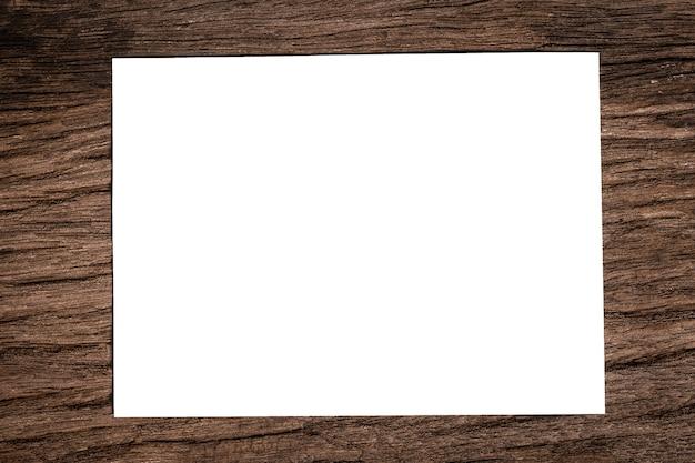 Biała księga na drewnianej podłodze w tle szczegółowo art