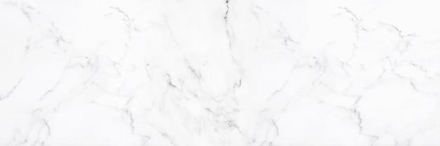 Biała marmurowa tekstura kamienia lub luksusowe płytki podłogowe i tapety dekoracyjne.