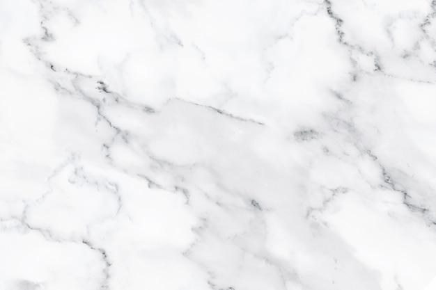 Biała marmurowa tekstura z naturalnym wzorem dla tła, projekta lub grafiki