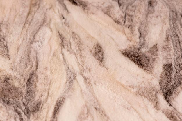 Biała miękka wełna tekstura tło, futro z delikatnym brzoskwiniowym odcieniem