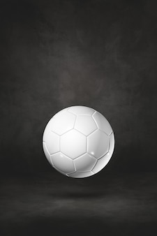 Biała piłka na białym tle na tle czarnego studia. ilustracja 3d