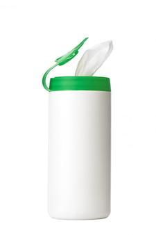 Biała plastikowa butelka z zieloną nakrętką bez etykiety z miejscem na kopię. bank do przechowywania produktów higienicznych, chusteczek nawilżanych. produkty kosmetyczne na białej ścianie.