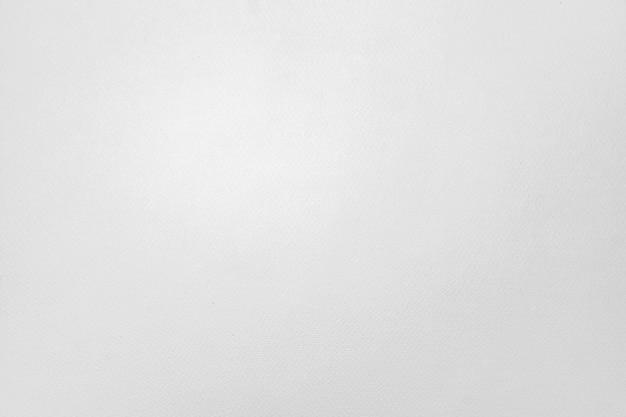 Biała, prosta i przejrzysta tekstura papieru do rysowania z miejscem na tekst lub grafikę.