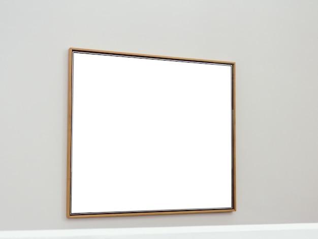 Biała prostokątna powierzchnia z brązowymi ramkami przymocowanymi do ściany