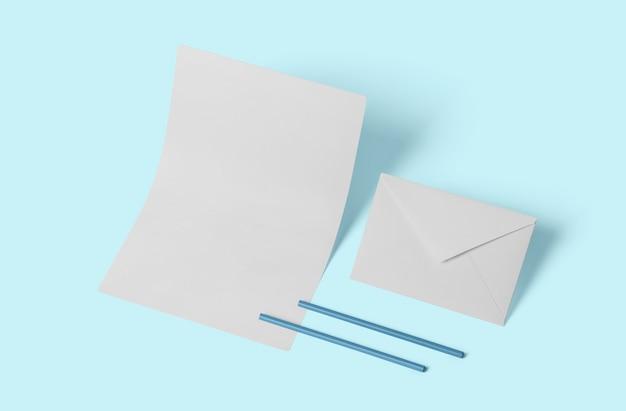 Biała pusta makieta papeterii, dodaj swój projekt. prosty powrót do koncepcji szkoły na miękkim niebieskim tle.