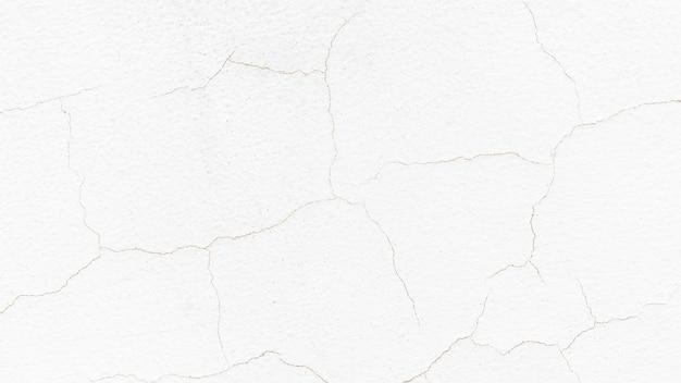 Biała ściana pęknięty tekstury tła