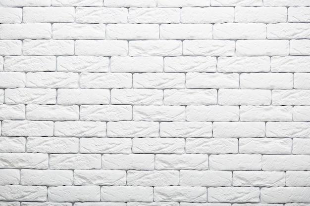 Biała ściana z cegieł tekstura dla twój tła. pokój wiejski. streszczenie strzał. struktura vintage. wybiel elewację. skopiuj miejsce na reklamę