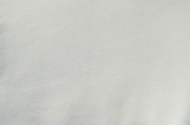 Biała skóra tekstura tło. czysty materiał wykonany ze skóry zwierzęcej na meble