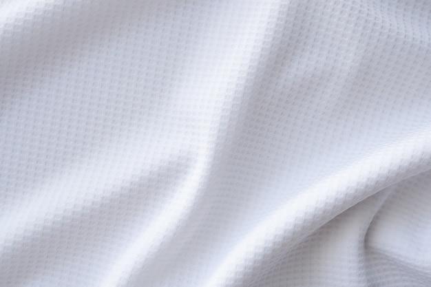 Biała sportowa tkanina odzieżowa koszulka piłkarska jersey tekstura streszczenie tło