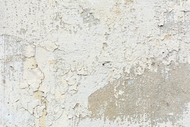 Biała stara tekstura farby pęka i pęka na ścianie