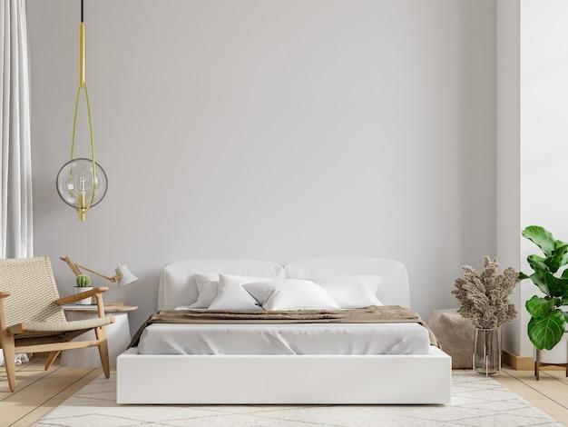 Biała sypialnia z fotelem na ścianie