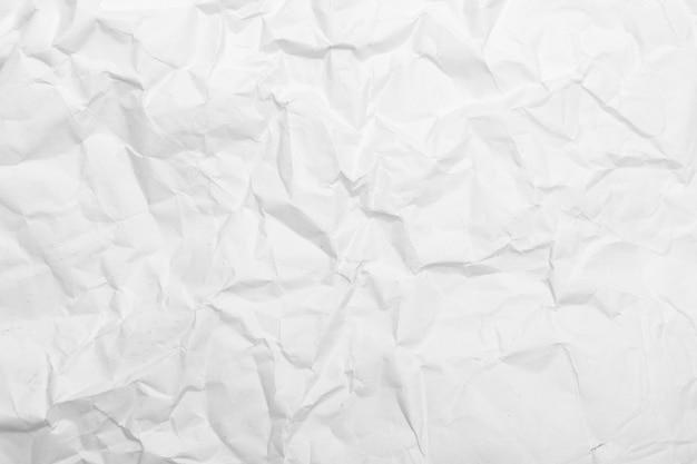 Biała tekstura zmięty papier.