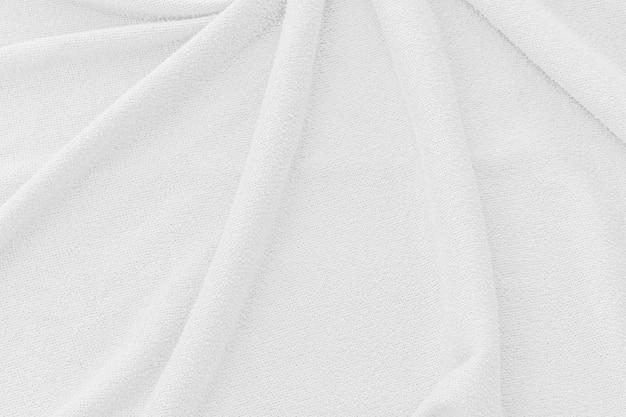 Biała tkanina tekstura tło. fala streszczenie powierzchni płótna.