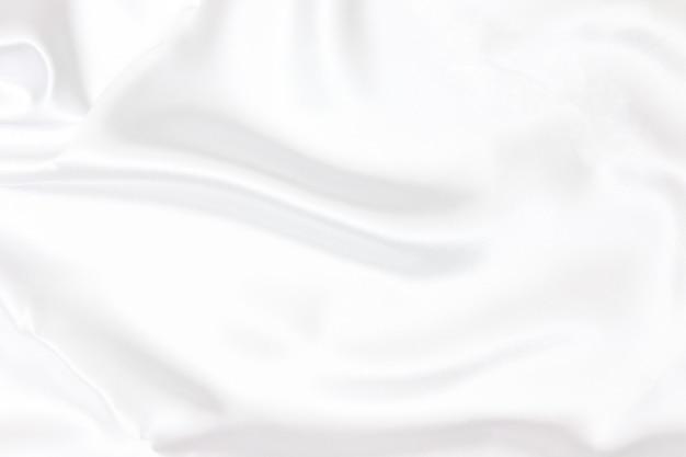 Biała tkanina tekstura tło. gładki elegancki biały jedwab może służyć jako tło weselne.