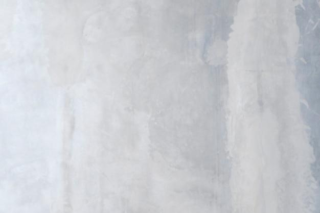 Białe betonowe podłogi teksturowane tło