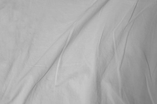 Białe delikatne miękkie tło z tkaniny lub prześcieradła