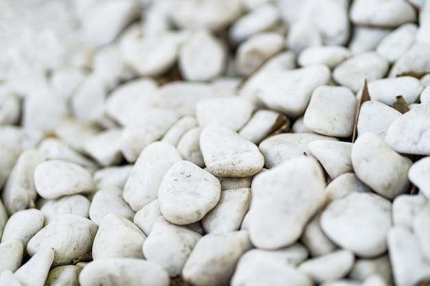 Białe kamyki kamienne tekstury i tła