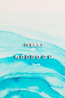 Białe koraliki hello january słowo typografia