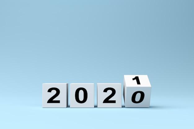 Białe kostki z napisem 2020 zastępuje rok 2021 na niebieskim tle, renderowanie 3d