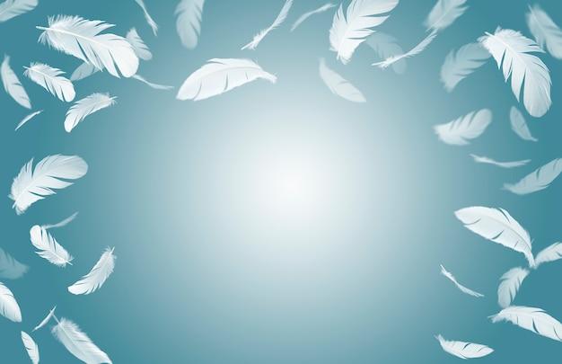 Białe pióra spadające w powietrze