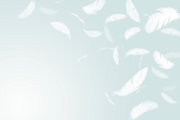 Białe pióra unoszące się w powietrzu.