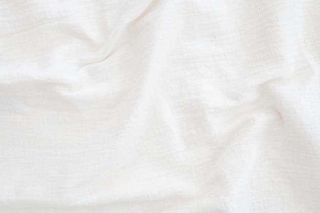 Białe płótno lniane pogniecione naturalne tkaniny bawełniane naturalne ręcznie robione lniane tło widok z góry