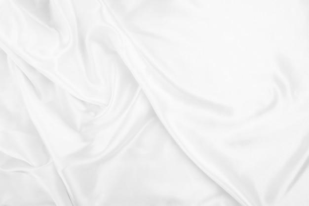 Białe płótno streszczenie tło z miękkimi falami, zbliżenie tekstury tkaniny