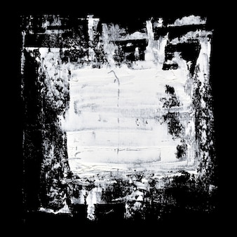 Białe pociągnięcia pędzlem grunge na czarnym tle