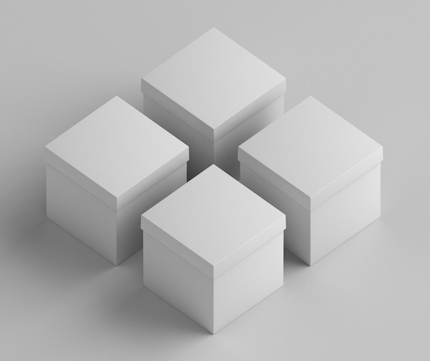 Białe puste, uproszczone kwadratowe pudełka kartonowe