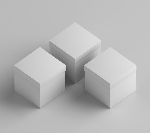 Białe puste, uproszczone pudełka kartonowe