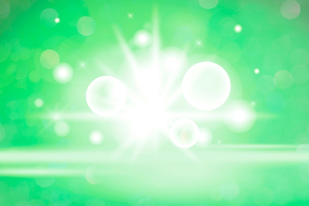 Białe światło bokeh na zielonym tle
